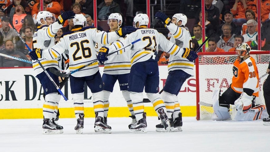 Buffalo Sabres' Matt Moulson (26) gathers his teammates together after scoring his second goal on Philadelphia Flyers' Michal Neuvirth, right, during the second period of an NHL hockey game, Tuesday, Oct. 25, 2016, in Philadelphia. (AP Photo/Chris Szagola)