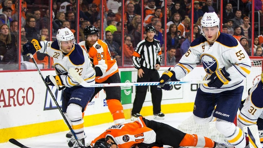 Buffalo Sabres' Rasmus Ristolainen, right, heads away after checking Philadelphia Flyers' Travis Konecny, center, from behind and drawing the penalty during the second period of an NHL hockey game, Tuesday, Oct. 25, 2016, in Philadelphia. (AP Photo/Chris Szagola)