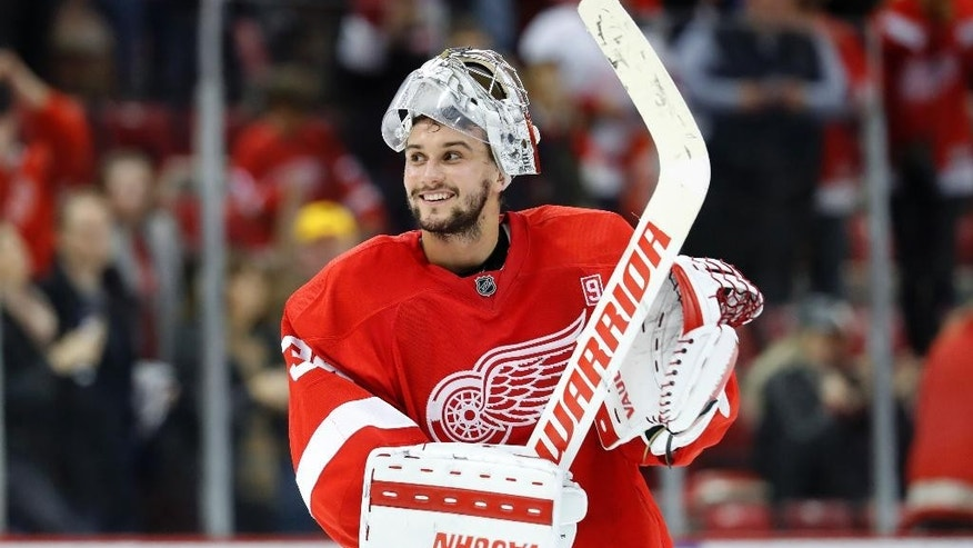 Detroit Red Wings goalie Petr Mrazek (34) smiles after beating the the Carolina Hurricanes 4-2 in an NHL hockey game in Detroit, Tuesday, Oct. 25, 2016. (AP Photo/Paul Sancya)