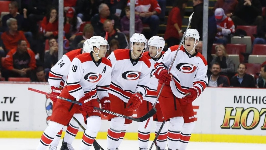 Carolina Hurricanes center Victor Rask (49) celebrates his goal with teammates against the Detroit Red Wings in the second period of an NHL hockey game in Detroit, Tuesday, Oct. 25, 2016. (AP Photo/Paul Sancya)