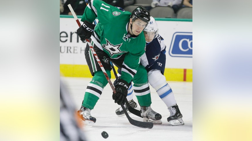 Dallas Stars left wing Curtis McKenzie (11) and Winnipeg Jets center Alexander Burmistrov (91) position to play the puck during the first period of an NHL hockey game Tuesday, Oct. 25, 2016, in Dallas. (AP Photo/LM Otero)