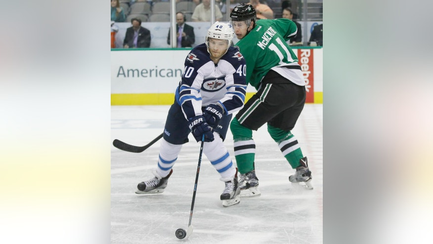 Winnipeg Jets right wing Joel Armia (40) takes control of the puck against Dallas Stars left wing Curtis McKenzie (11) during the first period of an NHL hockey game Tuesday, Oct. 25, 2016, in Dallas. (AP Photo/LM Otero)