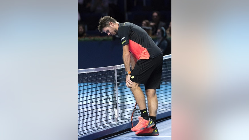 Switzerland's Stan Wawrinka gestures as he plays Switzerland's Marco Chiudinelli during their first round match, of the Swiss Indoors tennis tournament, at the St. Jakobshalle in Basel, Switzerland, on Tuesday, Oct. 25, 2016. (Georgios Kefalas/Keystone via AP)