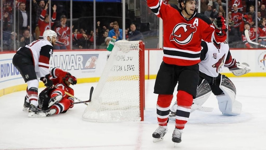 New Jersey Devils center Adam Henrique (14) celebrates after scoring a goal against the Arizona Coyotes during the second period of an NHL hockey game, Tuesday, Oct. 25, 2016, in Newark, N.J. (AP Photo/Julie Jacobson)