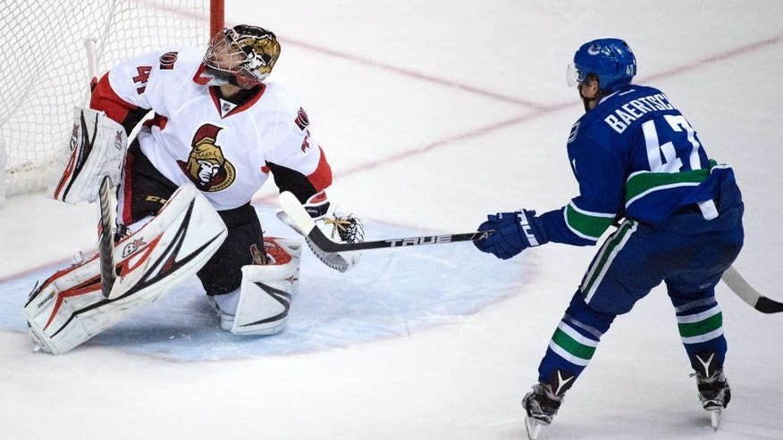 Ottawa Senators goalie Craig Anderson (41) stops a shot from Vancouver Canucks left wing Sven Baertschi (47) during the third period of an NHL hockey game, Tuesday, Oct. 25, 2016 in Vancouver, British Columbia.  (Jonathan Hayward/The Canadian Press via AP)
