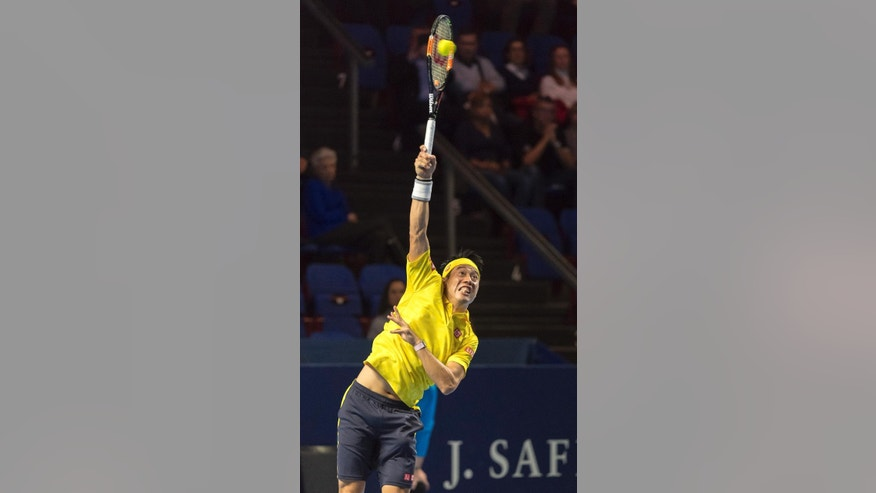 Japan's Kei Nishikori serves a ball to Italy's Paolo Lorenzi during their second round match at the Swiss Indoors tennis tournament at the St. Jakobshalle in Basel, Switzerland, Wednesday, Oct. 26, 2016. (Georgios Kefalas/Keystone via AP)
