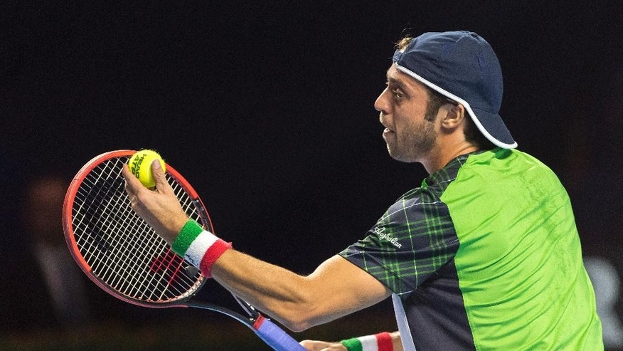 Italy's Paolo Lorenzi serves a ball to Japan's Kei Nishikori during their second round match at the Swiss Indoors tennis tournament at the St. Jakobshalle in Basel, Switzerland, Wednesday, Oct. 26, 2016. (Georgios Kefalas/Keystone via AP)