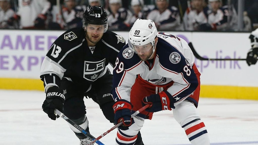 Columbus Blue Jackets center Sam Gagner (89) controls the puck in front of Los Angeles Kings left wing Kyle Clifford (13) during the first period of an NHL hockey game in Los Angeles, Tuesday, Oct. 25, 2016. (AP Photo/Alex Gallardo)