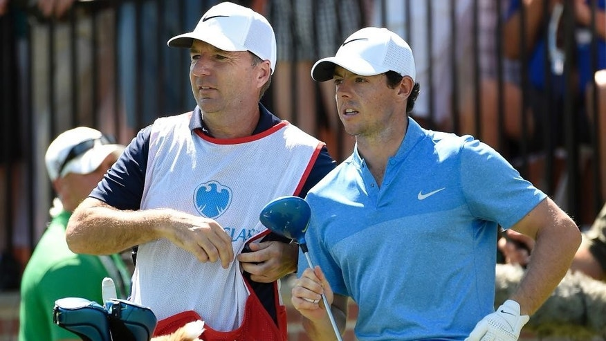 """In this Aug. 28, 2016 photo, Rory McIlroy of Northern Ireland, right,  and his caddy, J. P. Fitzgerald look down the fairway before McIlroy tees off from the first hole during the final round of The Barclays golf tournament in Farmingdale, N.Y..  McIlroy didn't have to check his bank account to know that his FedEx Cup bonus had been deposited. His caddie, J.P. Fitzgerald, informed him with a text message that a 'tsunami' had hit his account. McIlroy paid him a bonus of just over $1 million.  """"I think his words were, 'A tsunami just hit my bank account, so thank you very much,'"""" McIlroy said Wednesday, Oct. 26, 2016,  on the eve of the HSBC Champions. (AP Photo/Kathy Kmonicek)"""