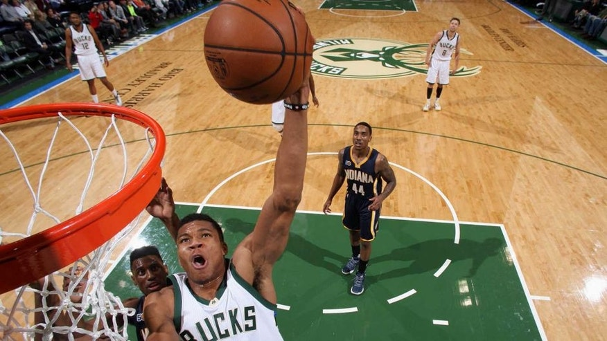 Milwaukee, WI - OCTOBER 19: Giannis Antetokounmpo #34 of the Milwaukee Bucks goes to the basket against the Indiana Pacers during a preseason game on October 19, 2016 at the BMO Harris Bradley Center in Milwaukee, Wisconsin. NOTE TO USER: User expressly acknowledges and agrees that, by downloading and or using this Photograph, user is consenting to the terms and conditions of the Getty Images License Agreement. Mandatory Copyright Notice: Copyright 2016 NBAE (Photo by Gary Dineen/NBAE via Getty Images)