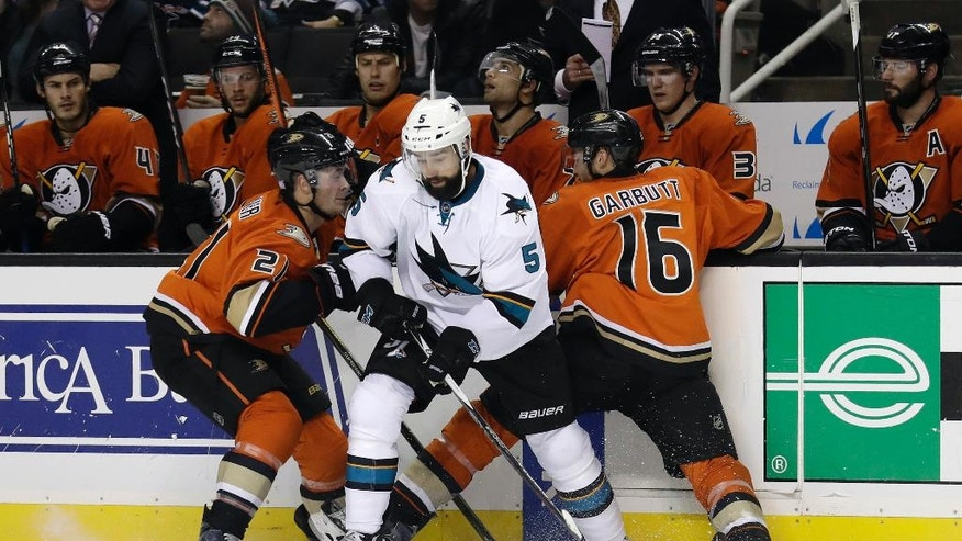 San Jose Sharks' David Schlemko (5) works against Anaheim Ducks' Ryan Garbutt (16) and Chris Wagner during the first period of an NHL hockey game Tuesday, Oct. 25, 2016, in San Jose, Calif. (AP Photo/Marcio Jose Sanchez)