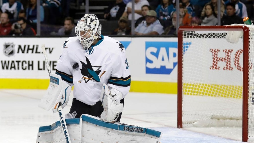 San Jose Sharks goalie Martin Jones stops a shot against the Anaheim Ducks during the second period of an NHL hockey game Tuesday, Oct. 25, 2016, in San Jose, Calif. (AP Photo/Marcio Jose Sanchez)