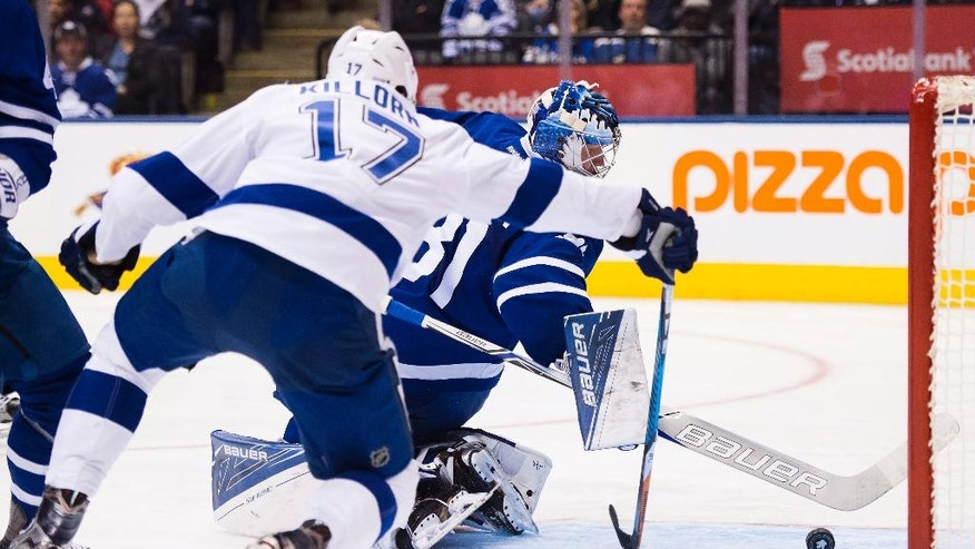 Tampa Bay Lightning's Alex Killorn (17) scores past Toronto Maple Leafs goalie Frederik Andersen (31) during the first period of an NHL hockey game, Tuesday, Oct. 25, 2016 2016 in Toronto. (Nathan Denette/The Canadian Press via AP)