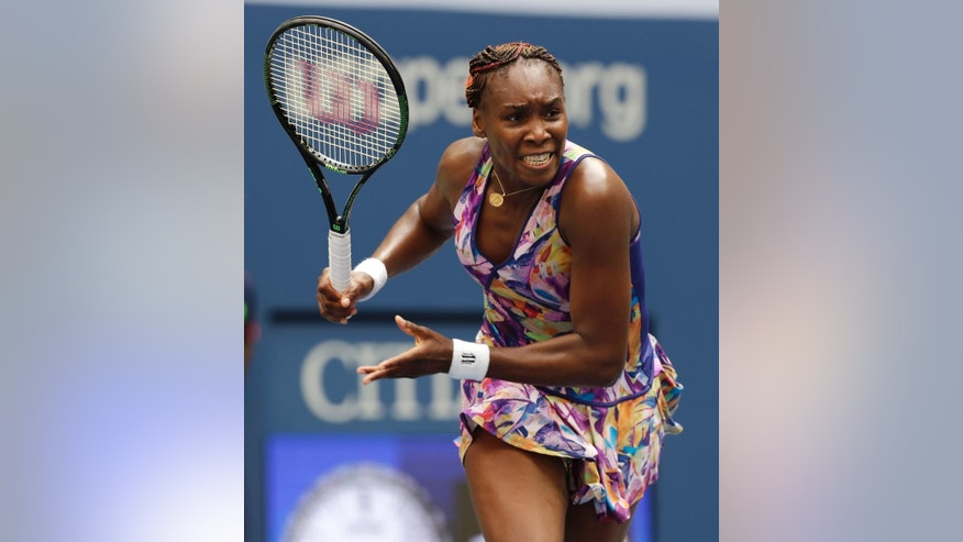 FILE - In this Sept. 5, 2016, file photo, Venus Williams returns a shot to Karolina Pliskova, of the Czech Republic, during the fourth round of the U.S. Open tennis tournament, in New York. Major champions Juan Martin del Potro, Venus Williams and Garbine Muguruza are among the tennis players taking part in exhibition matches at Madison Square Garden on March 6. Also participating: recently suspended top-15 player Nick Kyrgios. (AP Photo/Charles Krupa, File)