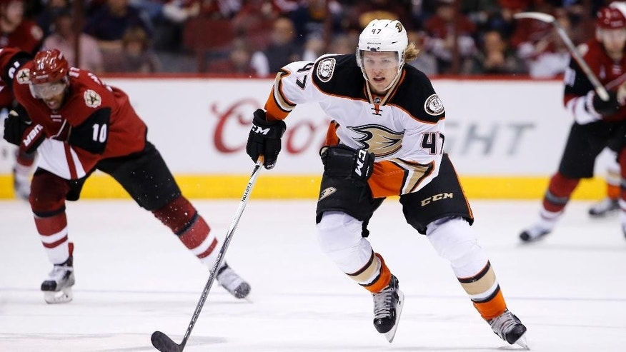 FILE - In this March 3, 2016, file photo, Anaheim Ducks' Hampus Lindholm (47), of Sweden, skates during the second period of an NHL hockey game against the Arizona Coyotes, in Glendale, Ariz. The Anaheim Ducks have signed holdout defenseman Hampus Lindholm to a six-year, $31.5 million contract. The Ducks announced the end of the stalemate Thursday, Oct. 27, 2016. (AP Photo/Ross D. Franklin, File)