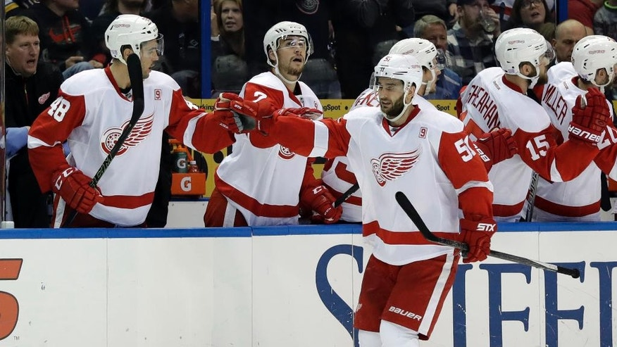 Detroit Red Wings' Frans Nielsen, of Denmark, is congratulated by teammates Ryan Sproul (48) and Brendan Smith, center, after scoring during the second period of an NHL hockey game against St. Louis Blues, Thursday, Oct. 27, 2016, in St. Louis. (AP Photo/Jeff Roberson)