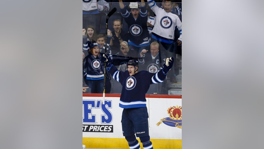 Winnipeg Jets' Tyler Myers (57) celebrates his goal against the Dallas Stars during the first period of an NHL hockey game in Winnipeg, Manitoba, Thursday, Oct. 27, 2016. (John Woods/The Canadian Press via AP)
