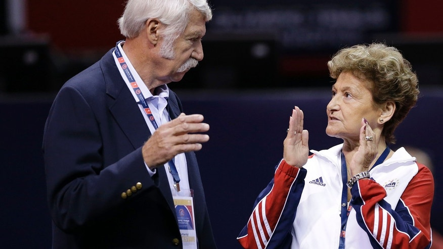 June 29, 2012: Bela Karolyi, left, and his wife Martha Karolyi talk on the arena floor before the start of the preliminary round of the women's Olympic gymnastics trials in San Jose, Calif.