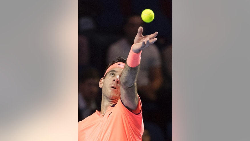 Argentina's Juan Martin Del Potro serves a ball to Belgium's David Goffin during their second round match at the Swiss Indoors tennis tournament at the St. Jakobshalle in Basel, Switzerland, Thursday, Oct. 27, 2016. (Georgios Kefalas/Keystone via AP)