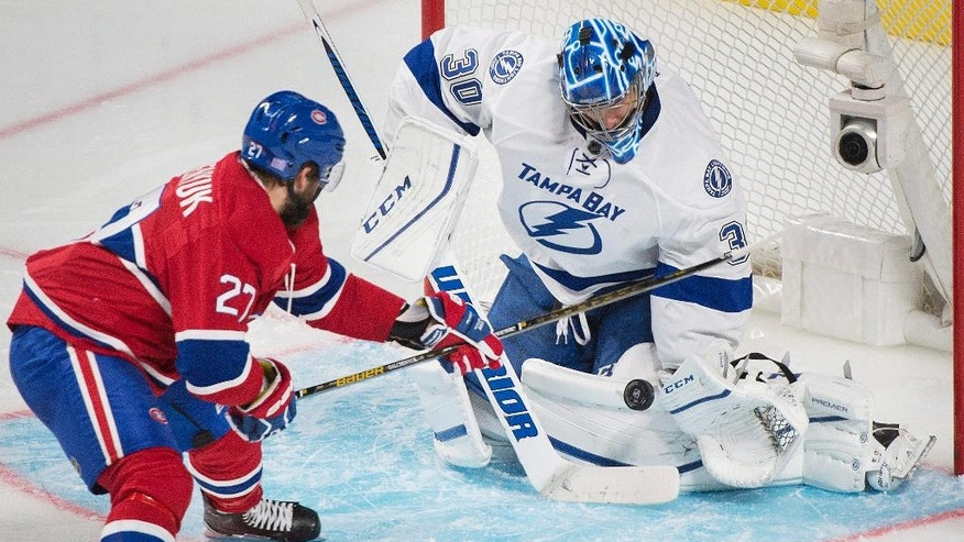 Tampa Bay Lightning goaltender Ben Bishop makes a save against Montreal Canadiens' Alex Galchenyuk during the second period of an NHL hockey game in Montreal on Thursday, Oct. 27, 2016. (Graham Hughes/The Canadian Press via AP)