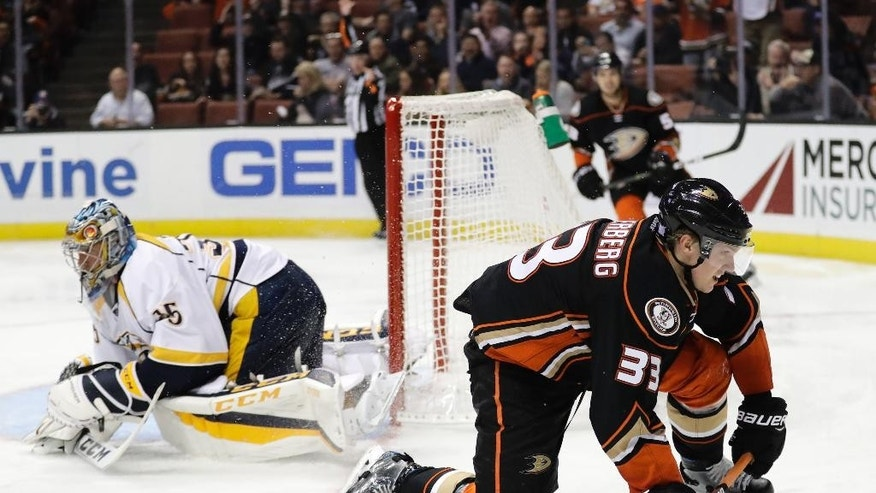 Anaheim Ducks' Jakob Silfverberg, right, of Sweden, slides past Nashville Predators goalie Pekka Rinne, of Finland, after scoring a goal during the second period of an NHL hockey game Wednesday, Oct. 26, 2016, in Anaheim, Calif. (AP Photo/Jae C. Hong)