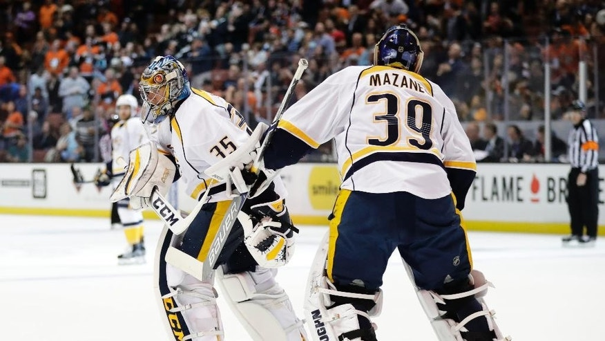 Nashville Predators goalie Pekka Rinne, left, of Finland, is relieved by goalie Marek Mazanec, of the Czech Republic, during the second period of an NHL hockey game against Anaheim Ducks Wednesday, Oct. 26, 2016, in Anaheim, Calif. (AP Photo/Jae C. Hong)