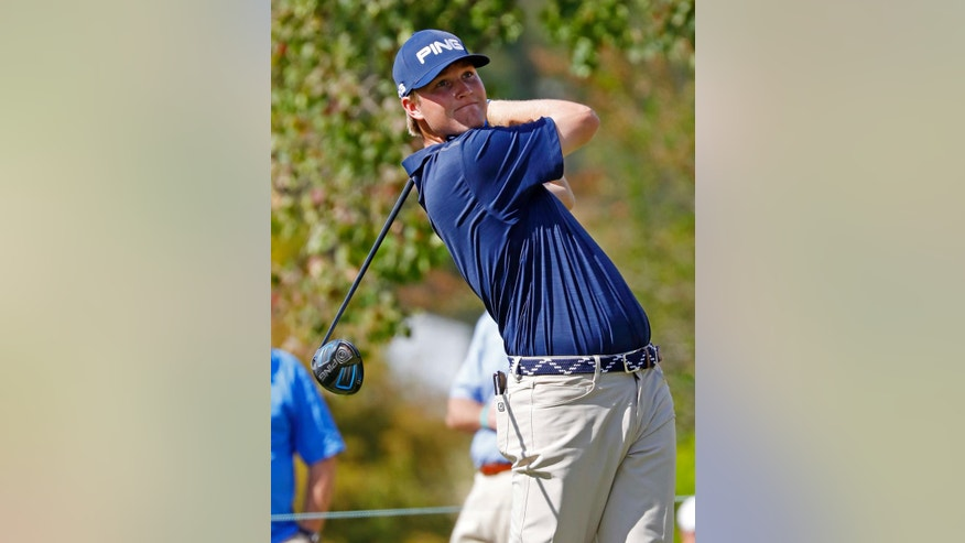 Trey Mullinax watches his tee shot on the No. 5 tee on the first day of the Sanderson Farms Championship in Jackson, Miss., Thursday, Oct. 27, 2016. (AP Photo/Rogelio V. Solis)