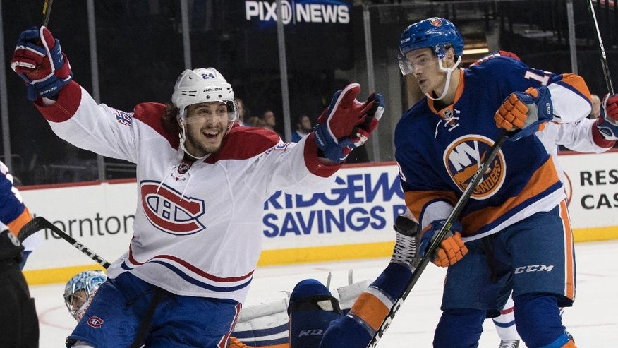 Montreal Canadiens left wing Phillip Danault (24) reacts after scoring a goal during the third period of an NHL hockey game against the New York Islanders, Wednesday, Oct. 26, 2016 in New York. The Canadiens won 3-2. (AP Photo/Mary Altaffer)