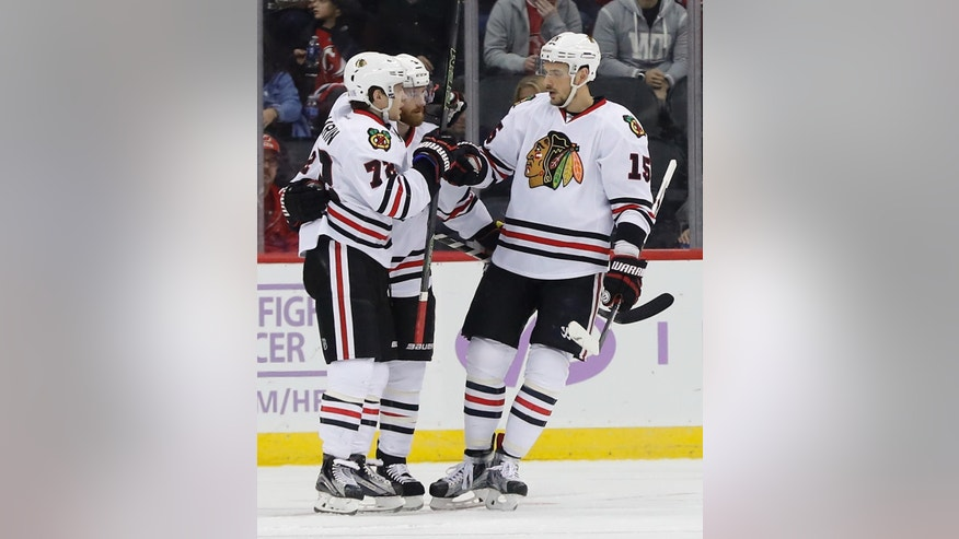 Chicago Blackhawks left wing Artemi Panarin (72) celebrates with teammates after scoring a goal against the New Jersey Devils during the second period of an NHL hockey game, Friday, Oct. 28, 2016, in Newark, N.J. (AP Photo/Julie Jacobson)