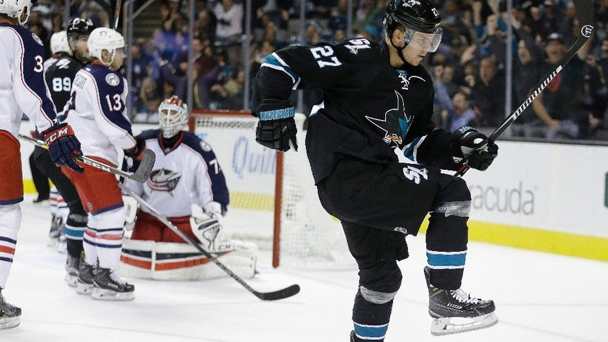 San Jose Sharks' Joonas Donskoi, right, celebrates after scoring a goal against Columbus Blue Jackets goalie Sergei Bobrovsky, center, during the first period of an NHL hockey game Thursday, Oct. 27, 2016, in San Jose, Calif. (AP Photo/Ben Margot)