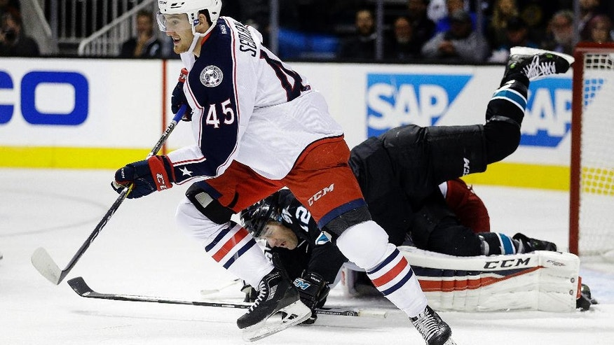 Columbus Blue Jackets' Lukas Sedlak (45) and San Jose Sharks' Patrick Marleau (12) fight for the puck during the first period of an NHL hockey game Thursday, Oct. 27, 2016, in San Jose, Calif. (AP Photo/Ben Margot)