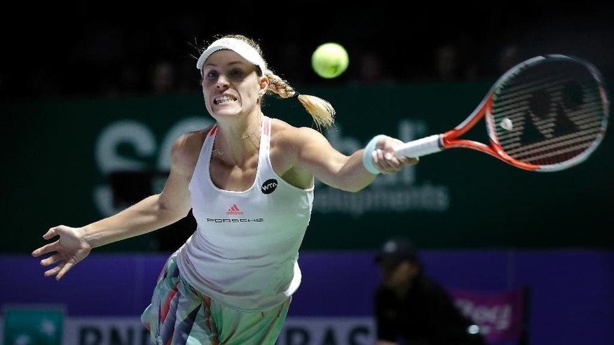 Angelique Kerber of Germany make a forehand return against Madison Keys of the United States during their singles match at the WTA tennis tournament in Singapore, Thursday, Oct. 27, 2016. (AP Photo/Wong Maye-E)