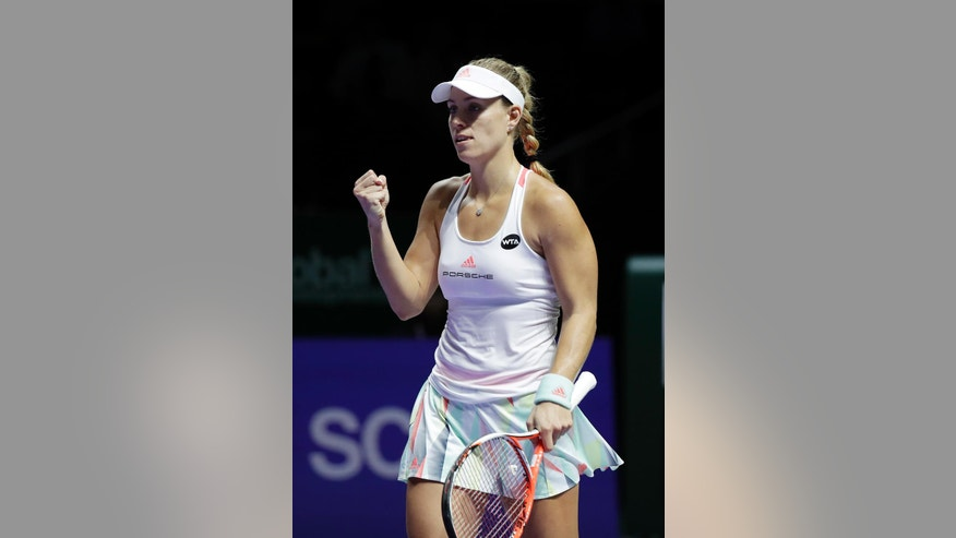 Angelique Kerber of Germany celebrates after beating Madison Keys of the United States during their singles match at the WTA tennis tournament in Singapore, Thursday, Oct. 27, 2016. (AP Photo/Wong Maye-E)