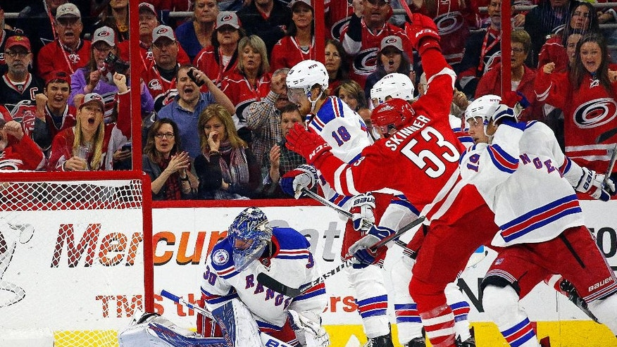 Carolina Hurricanes' Jeff Skinner (53) splits the defense to shoot the puck at New York Rangers goalie Henrik Lundqvist (30) for a goal during the first period of an NHL hockey game, Friday, Oct. 28, 2016, in Raleigh, N.C. (AP Photo/Karl B DeBlaker)