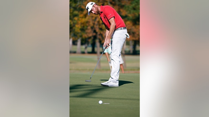 Chris Kirk watches his putt on the 17th green skirt the hole during the third round of the Sanderson Farms Championship golf tournament in Jackson, Miss., Saturday, Oct. 29, 2016. Kirk was among one of the day's leaders. (AP Photo/Rogelio V. Solis)