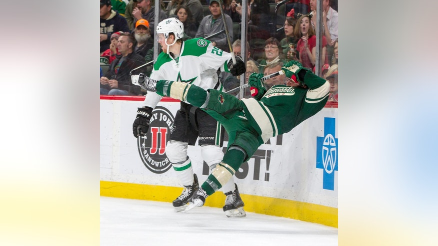 Minnesota Wild defenseman Jared Spurgeon (46) is knocked off his feet by Dallas Stars right wing Brett Ritchie (25) during the second period of an NHL game, Saturday, Oct. 29, 2016, in St. Paul, Minn. (AP Photo/Paul Battaglia)