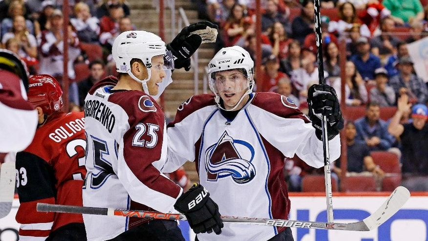 Colorado Avalanche center Matt Duchene (9) celebrates his goal against the Arizona Coyotes with Mikhail Grigorenko (25) during the second period of an NHL hockey game Saturday, Oct. 29, 2016, in Glendale, Ariz. (AP Photo/Ross D. Franklin)