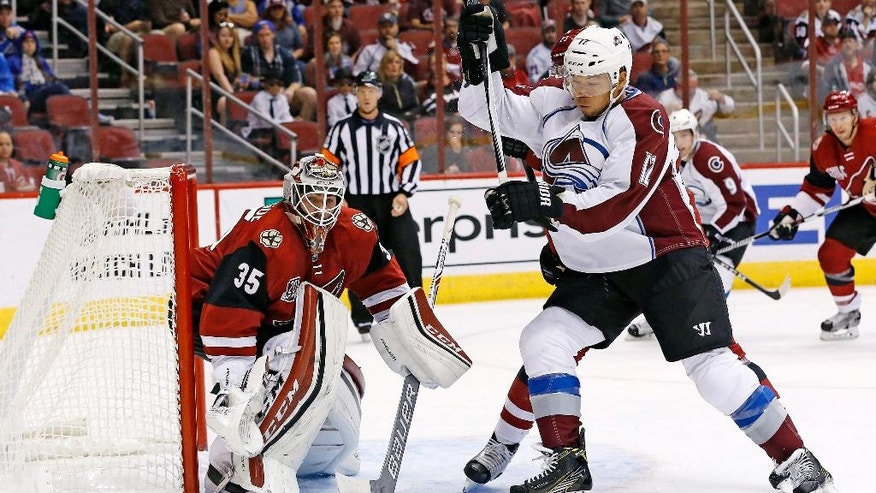 Arizona Coyotes goalie Louis Domingue (35) makes a save on a shot by Colorado Avalanche right wing Jarome Iginla (12) during the first period of an NHL hockey game Saturday, Oct. 29, 2016, in Glendale, Ariz. (AP Photo/Ross D. Franklin)