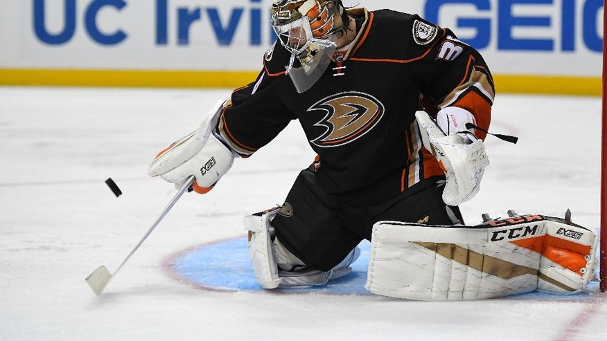 Anaheim Ducks goalie John Gibson stops a Columbus Blue Jackets shot during the third period of an NHL hockey game Friday, Oct. 28, 2016, in Anaheim, Calif. The Blue Jackets won 4-0. (AP Photo/Mark J. Terrill)