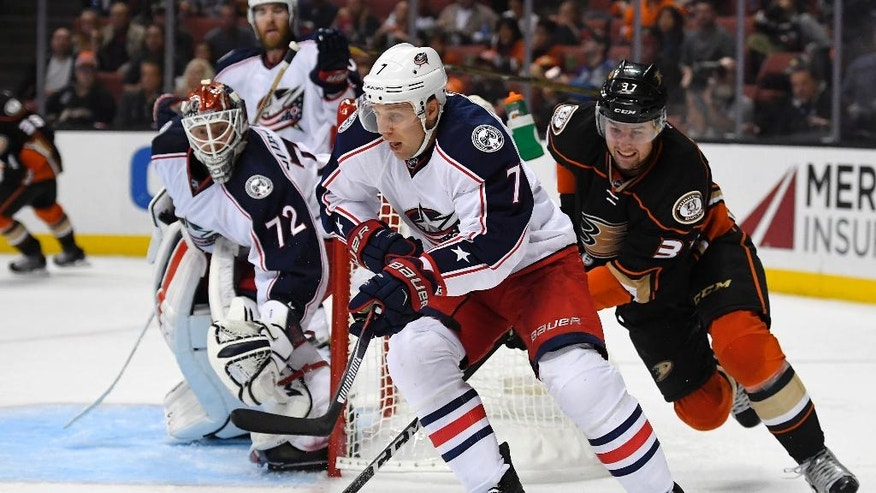 Columbus Blue Jackets defenseman Jack Johnson, center, skates with the puck as Anaheim Ducks left wing Nick Ritchie, right, gives chase and Blue Jackets goalie Sergei Bobrovsky, of Russia, watches during the second period of an NHL hockey game, Friday, Oct. 28, 2016, in Anaheim, Calif. (AP Photo/Mark J. Terrill)
