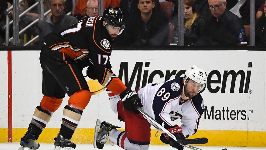 Columbus Blue Jackets center Sam Gagner, right, falls as he works for the puck against Anaheim Ducks center Ryan Kesler during the second period of an NHL hockey game, Friday, Oct. 28, 2016, in Anaheim, Calif. (AP Photo/Mark J. Terrill)