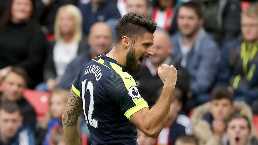 Arsenal's Olivier Giroud celebrates after scoring his side's third goal of the game during their English Premier League soccer match against Sunderland at the Stadium of Light, Sunderland, England, Saturday, Oct. 29, 2016. (Owen Humphreys/PA via AP)