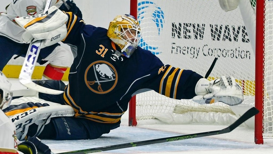 Buffalo Sabres goalie Anders Nilsson (31) makes a save during the second period of a NHL hockey game against the florida Panthers, Saturday, Oct. 29, 2016, in Buffalo, N.Y. (AP Photo/Jeffrey T. Barnes)