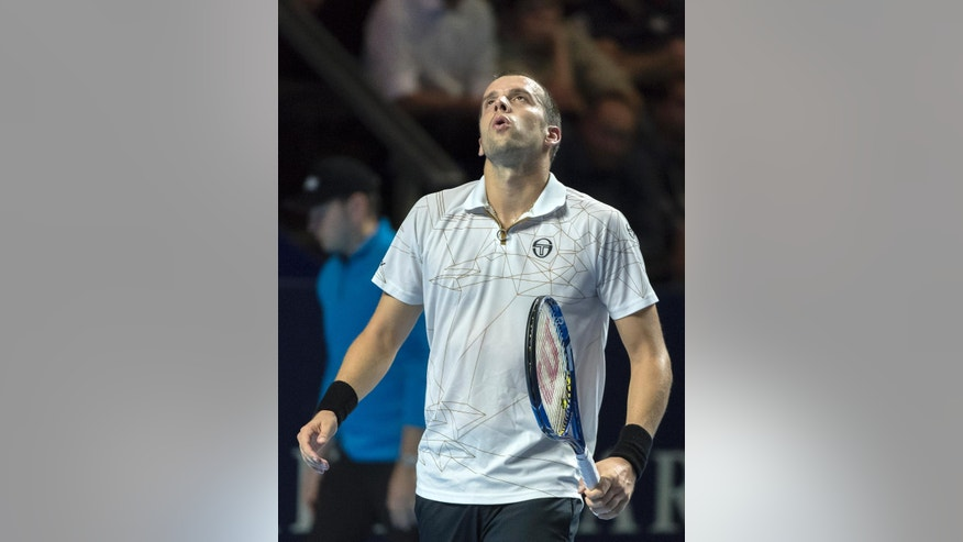 Luxembourg's Gilles Muller reacts during his semifinal match against Japan's Kei Nishikori at the Swiss Indoors tennis tournament at the St. Jakobshalle in Basel, Switzerland, Saturday, Oct. 29, 2016. (Georgios Kefalas/Keystone via AP)