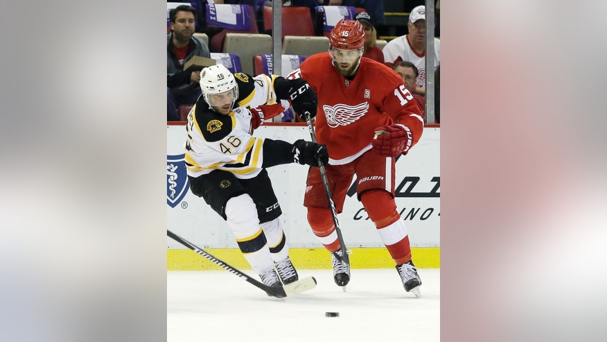 Boston Bruins center David Krejci (46), of the Czech Republic, maintains control of the puck against Detroit Red Wings center Riley Sheahan (15) during the first period of an NHL hockey game Saturday, Oct. 29, 2016, in Detroit. (AP Photo/Duane Burleson)