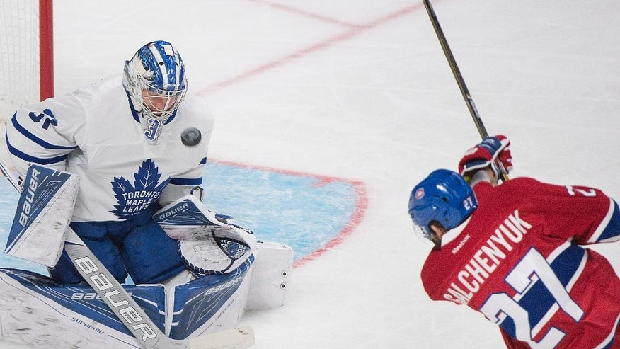 Toronto Maple Leafs goaltender Frederik Andersen makes a save against Montreal Canadiens' Alex Galchenyuk during first period NHL hockey action in Montreal, Saturday, Oct. 29, 2016. (Graham Hughes/The Canadian Press via AP)