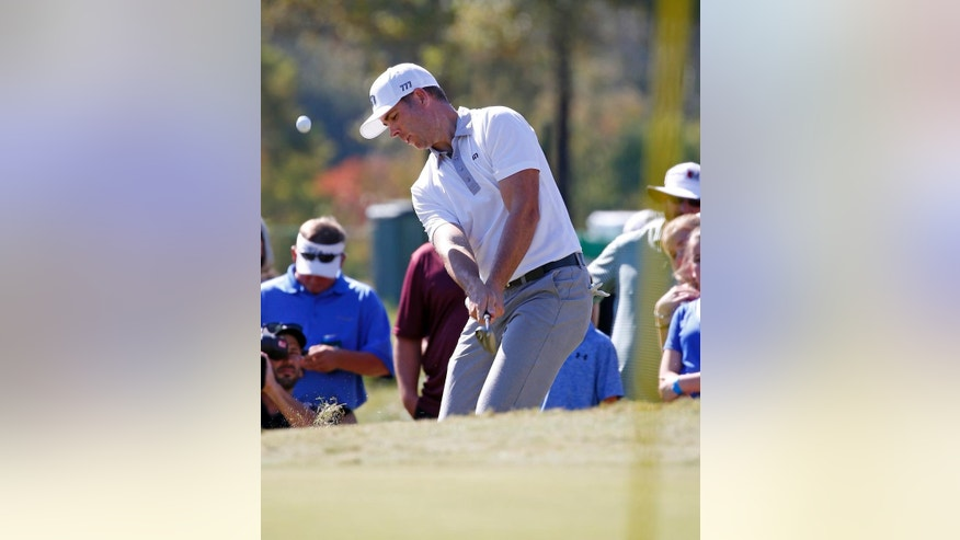 Luke List hits toward the eighth hole pin from the rough fairway during the final round of the Sanderson Farms Championship golf tournament in Jackson, Miss., Sunday, Oct. 30, 2016. (AP Photo/Rogelio V. Solis)