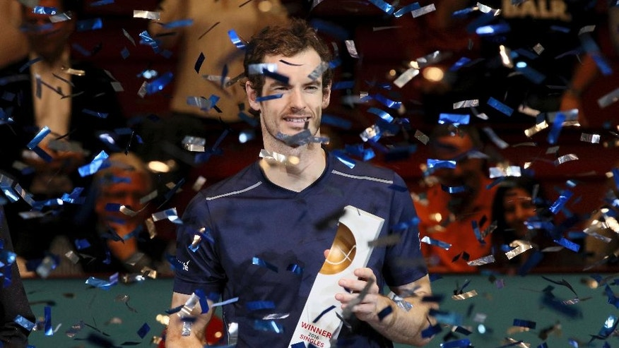 Andy Murray of Great Britain poses with the trophy amidst a shower of confetti after winning the final match against Jo-Wilfried Tsonga of France at the Erste Bank Open tennis tournament in Vienna, Austria, Sunday, Oct. 30, 2016. (AP Photo/Ronald Zak)