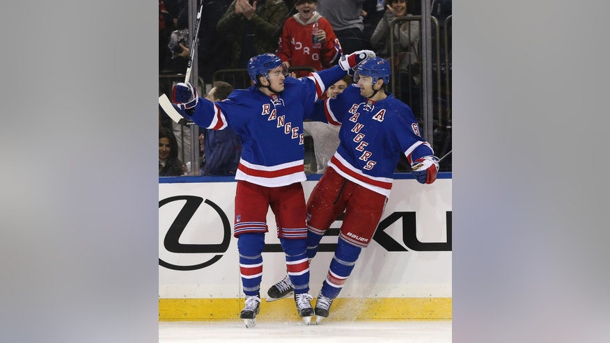 New York Rangers' Rick Nash, right, celebrates his goal with Jimmy Vesey during the second period of the NHL hockey game against Tampa Bay Lightning, Sunday, Oct. 30, 2016, in New York. (AP Photo/Seth Wenig)