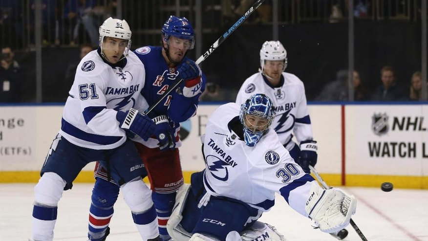 Tampa Bay Lightning goalie Ben Bishop, second from right, watches as a puck shot by New York Rangers' Jimmy Vesey scores past him during second period of the NHL hockey game, Sunday, Oct. 30, 2016, in New York. (AP Photo/Seth Wenig)